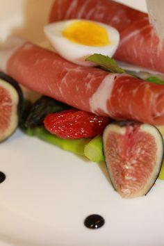 Fresh Italian meats, quail egg and figs.