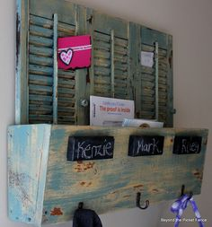 Beyond The Picket Fence  I LOVE this shutter organizer bin.  And the 2x4 chalkboard painted markers are cool