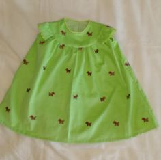 Toddler Lt Green Cordury fine wale w/ festive embroidered dogs. Gingham lining, zigzag & piping detail applied & sewn by hand.
