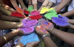 Holi - Indian Festival of Colors, welcoming Springtime. Students holding paint powder of various colors pose as they celebrate Holi, the Indian festival of colours, in the western Indian city of Ahmedabad March (REUTERS/Amit Dave) # Hindu Festivals, Indian Festivals, Holi Festival Of Colours, Holi Colors, Creating Communities, Holi Celebration, Les Religions, Team Building Activities, Festivals