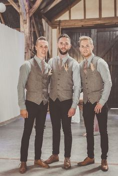 Groom and groomsmen wear tweed waistcoats and black jeans for an informal rustic wedding.