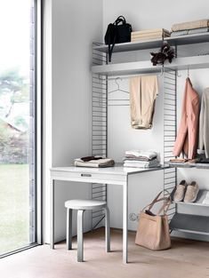 Modular storage for your bedroom. When fully constructed, the system includes shoe shelves, recessed trays, flat and tray shelves, as well as customisable rods from which clothes can be hung. Shelving Solutions, Shelving Systems, Interior Plants, Interior Design, String Regal, String Shelf, String System, Design Online Shop, Muuto