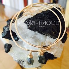 14k gold fill Hoops with Silverite drop. Resting on Black Toumaline in Matrix. #madeonmaui #love #maui #summer  Driftwood Maui - A Lifestyle Boutique In Makawao, HI