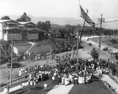 Erection of the first power pole of the Los Angeles city electric distribution system on March 30, 1916, on the site of the Arroyo Seco Branch of the Los Angeles Public Library. | Image courtesy of the Los Angeles Public Library