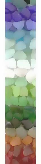 Sea glass in glass jars for the centerpiece at a beach wedding