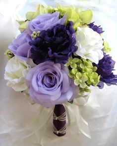 Wedding bouquet Bridal Silk flowers PURPLE LAVENDER GREEN Orchid Feathers Bridesmaids boutonnieres Corsages 17 pc package. $189.00, via Etsy.