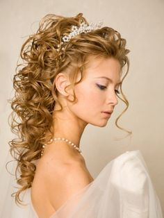A long blonde curly coloured wedding bridal ringlets Womens hairstyle by Wedding Collections