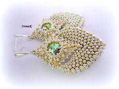 Silver earrings by IrenaK. Peyote stitch, graduated Japanese seed beads (silverplated), bezelled rivolis, sterling hooks.