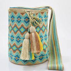New boho design with soft colors. Handcrafted handbags made by indigenous wayuu in the north of Colombia. Worldwide shipping – envíos mundiales – PayPal WA +57 3188430452 #seoul #ootd #mochilas #wayuu #handmade #boho #hippie #bohemian #trendy #knitting #australia #miami #Handgjord #Handgemacht #Handgemaakt #faitmain #london #australia #wayuubags #winter #Netherlands #handcrafted #fashion #style #france #newyotk #Japan #california #miami #Hæklet #newyork