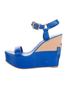 Cobalt pebbled leather Tory Burch platform wedge sandals with basketweave panels at mid soles, covered heels featuring logo patches, rubber outer soles and gold-tone buckle closures at ankle straps.
