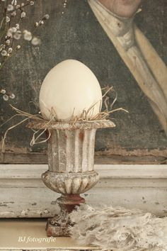 Egg in an urn. Dignified portrait of an ancestor.
