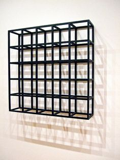 Sol LeWitt's Cubic-Modular Wall Structure, MOMA   Sol Lewitt was less interested in formal composition than absolutes in formal structure.