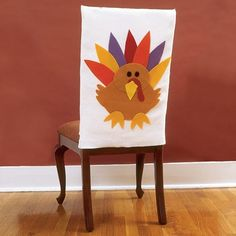 Thanksgiving Crafts: Turkey Chair Covers-- this could easily be adapted with a green Christmas tree with felt circles the kids can cut out for ornaments.