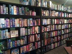 board game collection!     I want a wall of boardgames just like this in our bookstore!!