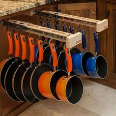 Dream Kitchen: Under-cabinet pot/pan organizer. This is effing incredible. I NEED this in my life.