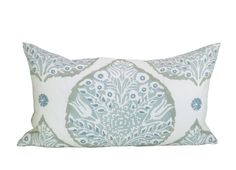 This listing is for one Lotus Mineral on Cream Linen lumbar pillow cover with linen backing. DESCRIPTION Fabric made by: Galbraith & Paul Pillow made by: Spark Modern Colors: Mineral blue/green, jade blue, taupe, cream   DETAILS Pattern placement WILL VARY from the listing photo. The pillow cover shown in the listing photo is 14 x 24 with a 14 x 24 down blend insert. Inserts are available for purchase through the following link, which also includes sizing recommendations: https:&#x2...