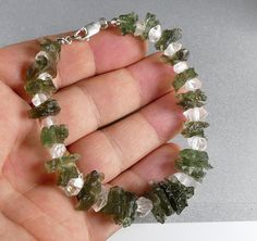 Genuine raw Moldavites with Herkimmer Diamond Quartz bracelet about 21 cm long with sterling silver closing This is handmade unique item you get what is on the picture Free gift box included Settings silver Sterling silver Dimensions mm 210 x 15 x 5 mm Healing Bracelets, Crystal Bracelets, Silver Bracelets, What Are Crystals, Diamond Quartz, Crystal Shop, Chakra Bracelet, Crystal Healing, Sterling Silver