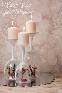 This beautiful Winter Painted Wine Glass Centerpiece is a unique addition to a holiday table, mantle, or even bookcase. Plus, it uses materials that you can get from the Dollar Store!
