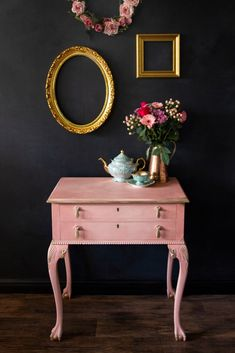 84 Square used Chalk Paint® by Annie Sloan in a custom Scandinavian Pink, a traditional earthy Swedish-style pink, and Old White mix on this side table. I love it against that deep black backdrop! Styled with pink roses and decadent gold frames. Painting Old Furniture, Pink Furniture, White Painted Furniture, Unique Furniture, Furniture Decor, Furniture Design, Custom Furniture, Vintage Furniture, Annie Sloan