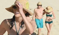 Hitting the golden sands of the Caribbean island on Sunday, the musical legend, 73, and his 56-year-old wife put on a tender display of affection as they enjoyed a romantic stroll along the shoreline.