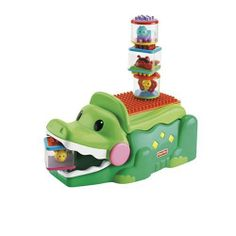Stack & Smile Crocodile by Fisher Price. $36.45. From the Manufacturer                A cute building center for baby that rewards baby for early building! This cute alligator's folded tail has a bumpy surface that aids baby in stacking the 4 new Peek-a-Blocks Builders blocks on - and it rewards baby with musical responses! When the tail i                                    Product Description                This friendly crocodile is a baby building center for early s...