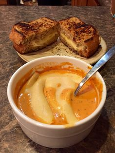 Grilled cheese on 12-grain wheat bread to dip in tomato basil soup, with a slice of muenster cheese melted over the top.