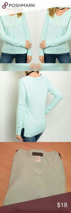 ✨Just added✨Soft mint sweater Long sleeve basic knit top, sweater has a v-neckline and fitted silhouette. Small slits on the side. ✨Soft material 100% Acrylic  ✨made in the USA. ✨Mint color shows well in 1st two pictures ✨Firm Sweaters V-Necks