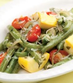 Braised Green Beans & Summer Vegetables - When green beans, summer squash and cherry tomatoes are plentiful in backyard gardens and farmers' markets, try this quick braise. We like the salty, nutty flavor of Parmesan, but you can use any flavorful cheese. Summer Vegetable Recipes, Healthy Summer Recipes, Green Bean Recipes, Vegetable Side Dishes, Veggie Recipes, Dinner Recipes, Uk Recipes, Vegetable Stock, Diabetic Recipes