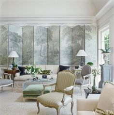 This 18th-century custom folding screen is paired with a custom sofa in Clarence House viscose-linen, pillows in velvet and Clarence House print, and an antique zinc pedestal.DESIGN BY RICHARD HALLBERG.Tour the entire home.    - Veranda.com