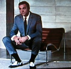 Sean Connery in Dr. No. Overdressed for Jamaica..?   Bond and Bond ...