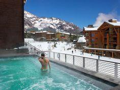 Best places to travel during the Chicago winter: Jackson Hole, Wyoming.  Photo of Hotel Terra slope side hot tub Jackson Hole
