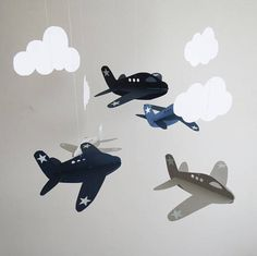 This adorable airplane mobile will be a lovely accent to any room. Babies especially, will love to watch the airplanes and clouds gentle movement. Unlike felt mobiles, this mobile is made with sturdy card-stock paper which is feathery light and will catch the slightest breeze,