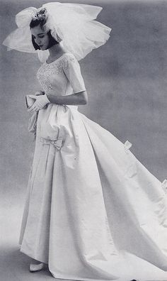 A beautiful bow adorned wedding dress from 1963. #vintage #1960s #weddings #dresses #brides