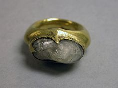 Ring with Inset Clear Stone Period: Central Javanese period Date: Second half of the 8th–second half of the 10th century Culture: Indonesia (Java) Medium: Gold with stone Dimensions: H. 1/8 in. (0.3 cm); Diam. 1 in. (2.5 cm) Classification: Jewelry Credit Line: The Samuel Eilenberg-Jonathan P. Rosen Collection of Indonesian Gold, Bequest of Samuel Eilenberg and Gift of Jonathan P. Rosen, 1998 Accession Number: 1998.544.340