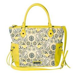 Add some sunshine to your life with the Star Satchel Handbag from Traditions by Waverly. This satchel bag features a paisley pattern in yellow, black, gray and white with sunny yellow top handles and an adjustable strap, and is sure to brighten up even the cloudiest day. Zipper pockets on each side mean that the items you need the most are always within reach.