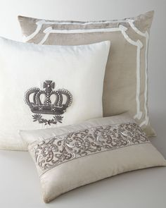Luxurious, artisan-crafted pillows bring drama and texture to room settings. The Angie square pillow is framed by an appliqued double border while the Kasmir oblong pillow and the Imperial Crown pillow feature dramatic zardozi metallic applique embroidery, an ancient form of embroidery once used to adorn the gowns and uniforms of Persian rulers.