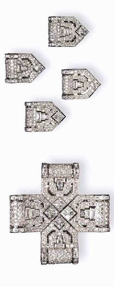 A RARE ART DECO DIAMOND CROSS BROOCH, BY CARTIER Of pierced openwork design, the pavé-set diamond sections enhanced by rectangular and French-cut diamond borders and terminals, alternately accented by baguette-cut diamonds, mounted in platinum and 18K gold, (may be worn as four clip brooches), circa 1930, with a French assay mark and maker's mark Signed Cartier, Nos. 02967 & 03010 (indistinct)