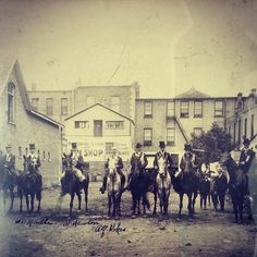 Men on houses in front of the Central Hotel Wild West, City, Instagram Posts, Painting, Vintage, Museum, Painting Art, Cities, Paintings