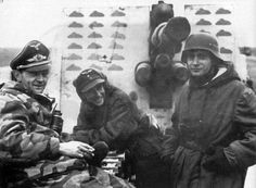 Members of the Wehrmacht Flak Corps smile for the photographer sitting astride their AA cannon. The armor plate protecting the crew bears the marks of enemy planes shot down. The Flak Corps was a Luftwaffe formation giving AA support to mainly ground formations. Toward the end of the war, many Flak crews ended up fighting as anti-tankers and, even, line infantry.