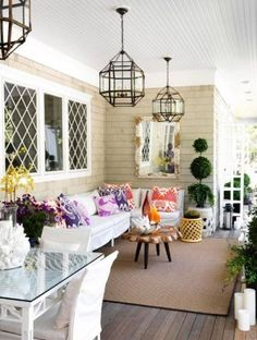 Lighting. It doesn't matter if it you choose onion lanterns, a shapely Moroccan pendant, marine sconces or candles, but that glaring motion-activated spotlight on the side of the house is not going to cut it. The right lighting lets you enjoy your porch on hot summer nights.