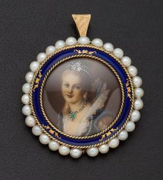 "Vintage Cultured Pearl & Enamel Portrait Brooch 18k yellow gold, 35 mm, painted portrait of the lady and is accented with 3 small diamonds, rim is accented with blue enamel & cultured pearls which are approximately 3 mm to 4 mm, the back is solid gold and marked ""Italy"