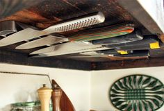 knife magnet bar under cabinets - 8 space-saving tricks for tiny kitchens via @PureWow