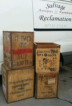 """stack of vintage wood tea chests or crates, lettered in various languages inc English """"It Pays to Buy Good Tea"""""""