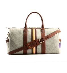 Savile Grey Heather Wool Felt Bag by Monte & Coe $429   These bags are designed and created in Toronto and celebrate the individual. They are practical and spacious, versatile and original, and showcase the wearer's dedication to personal style. Just the thing for nights away or running around the city   GOTSTYLE.ca