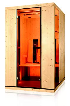 Die Ergo-Balance II Infrarotkabine mit LED-Farblichtbad,      Aromabad,      Fußboden mit integrierter Thermozone      Vollspektrum - Sonnenlicht,     ergonomisch geformte Armlehnen und bewegliche Rückenlehnen,      Handtuchhalter      vollelektronische Steuerung mit sensitivem Bedienfeld und integriertem MP3-Player      wahlweise Holz- oder Glasteile      Türmontage auch auf der Seite möglich