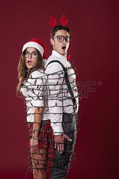 Nerd couple tangle in Christmas lights