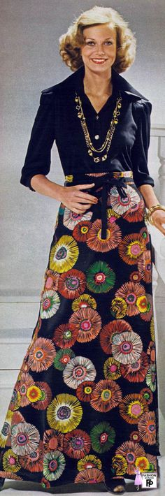 1975 vintage fashion style color photo print ad model magazine 70s hostess dress skirt shirt long maxi graphic print floral flower burst design colorful red yellow pink green black modern