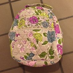 Vera Bradley lunchbox (used for toiletries) Some wear in the inside from makeup so I used it for toiletries and travel. Fits a full sized shampoo and conditioner and is lined in case of any spills! Vera Bradley Bags