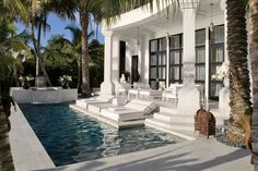 Best Swimming Pools : Architectural Digest - white marble paves an Egyptian-inspired Miami terrace and pool, designer Juan Montoya