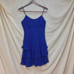 "Little blue dress Short royal blue spaghetti strap dress with tiered skirt. Comes with scarf (pic 3). Scarf has a small stain on it. Size 7/8. Measurements lying flat: bust 17"", underbust 15"", length mid bust to bottom hem 28"". Steppin Out Dresses Mini"